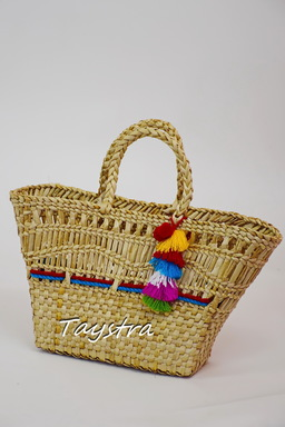 Handmade woven ladies bag decorated in ethnic style